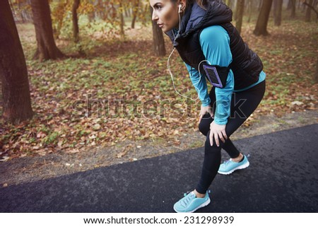 She likes morning run in park  - stock photo