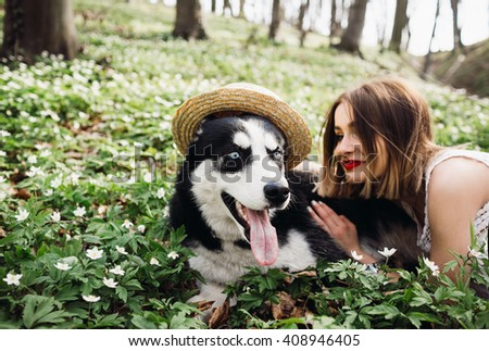 she loves her big dog - stock photo