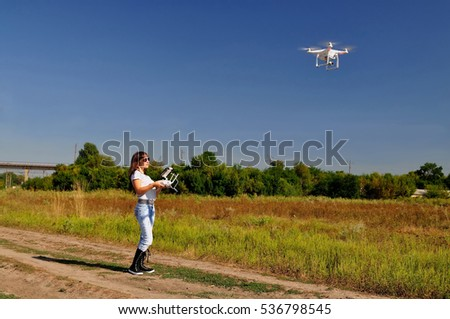 She manages the drone and watching him