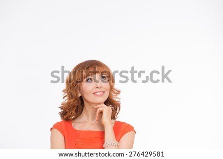 She need to take a descision what to choose. Beautiful woman in orange dress on white/ - stock photo