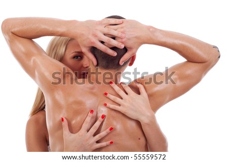She passionately embraced the man over white background - stock photo