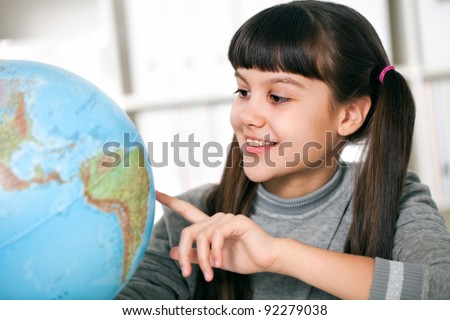she prepares the geography lesson - stock photo