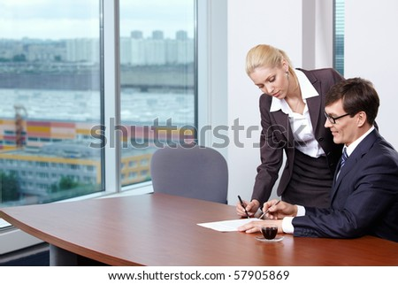 She signed the papers of his boss - stock photo