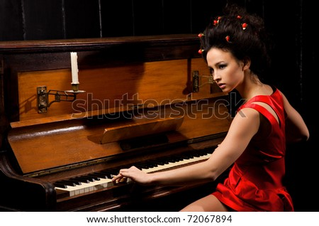 she studied music and plays the piano - stock photo