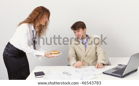 She treats colleague sandwich in the office - stock photo