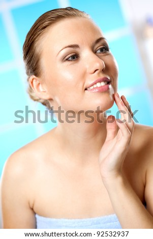 she tries a new makeup for the face - stock photo