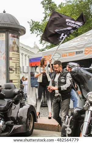 She waved flags. St. Petersburg, Russia - 12 August, 2016. The annual International Festival of Motor Harley Davidson in St. Petersburg Ostrovsky Square.