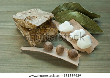 shea butter, african black soap on wooden - stock photo