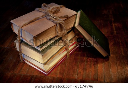 Sheaf of books on old wooden to a floor - stock photo