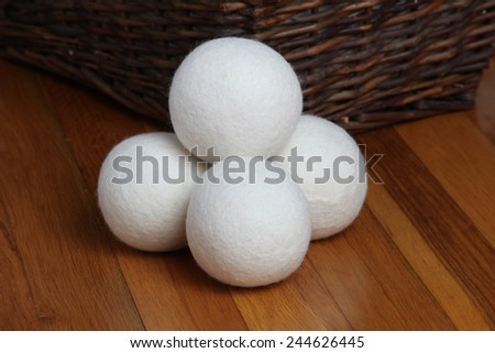 Sheep dryer ball on wooden floor - stock photo