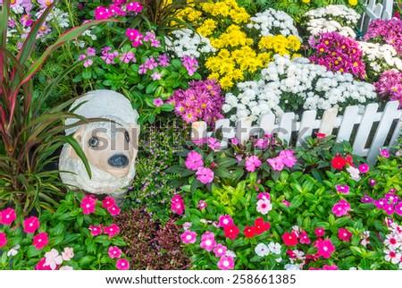 Sheep statue in flower garden. Flower garden. - stock photo