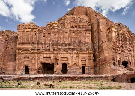 Sheeps grazing next to the Palace and Corinthian Tombs in the ancient city of Petra (Jordan) - stock photo