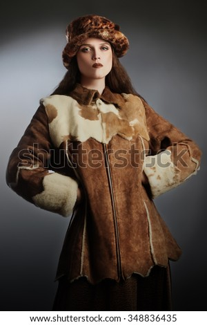 Sheepskin coat winter clothes Elegant woman fashion winter hat - stock photo