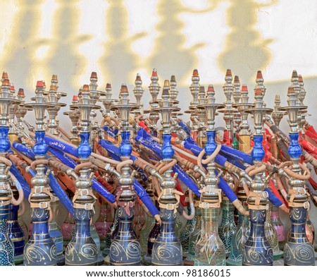 Sheesha smoking pipes at the souk in Doha in a with red and blue colors - stock photo