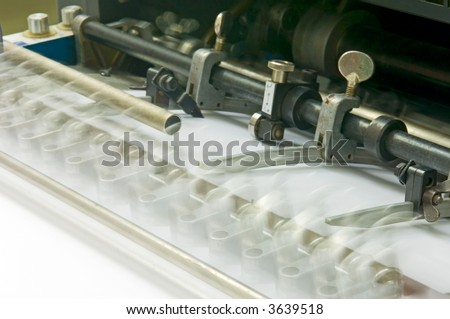 Sheet feeder in motion - stock photo