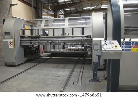 Sheet metal folding machine with loading platform - stock photo