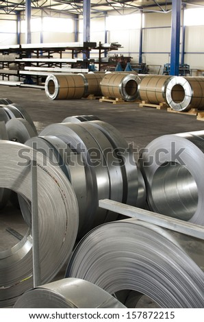 sheet metal rolls in production hall - stock photo