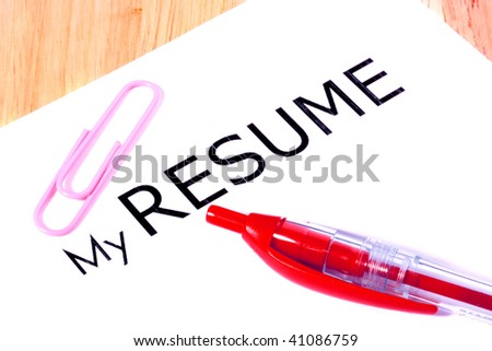 Sheet of a white paper with inscription My Resume, the red pen and a pink paper clip. - stock photo
