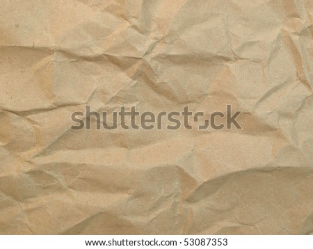 Sheet of brown and rippled paper background - stock photo