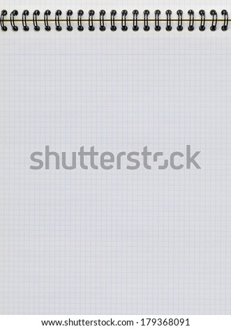 Sheet of graph paper in a vertical notebook. Study and education concept - stock photo