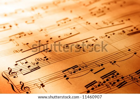 Sheet of musical symbols with warm lighting - stock photo