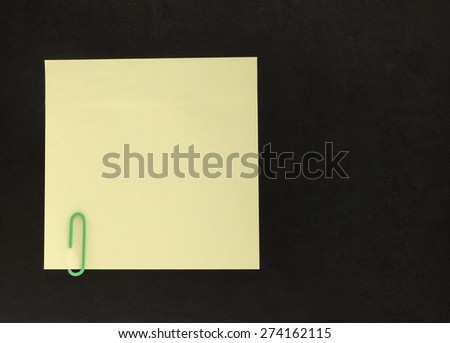 sheet of paper for notes on a black background - stock photo
