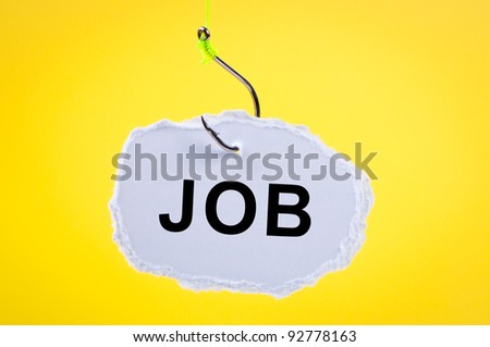 Sheet of paper hanging on fishing hook with word job. - stock photo