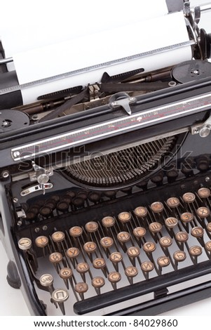 Sheet of paper inserted inro the vintage typewriter - stock photo