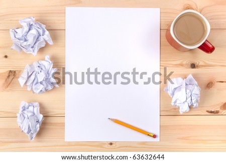 Sheet of paper on a desk - stock photo