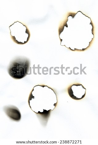 Sheet of paper with the burnt holes. Burn marks.  High resolution scanned image  - stock photo