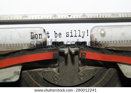 "Sheet of paper with the inscription ""Don't be silly""  in the typewriter"