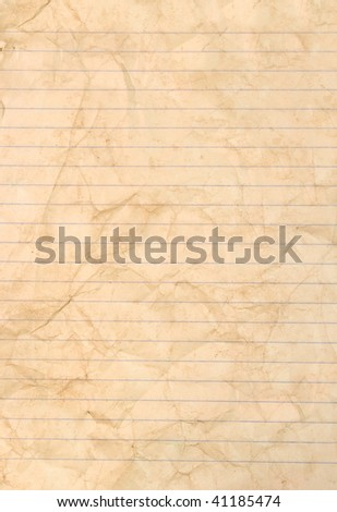 Sheet of stained lined paper - stock photo