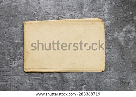 Sheet of vintage paper on grey background, copy space - stock photo