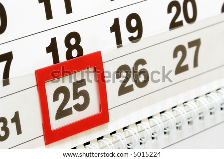 Sheet of wall calendar with red mark on  december 25 - stock photo