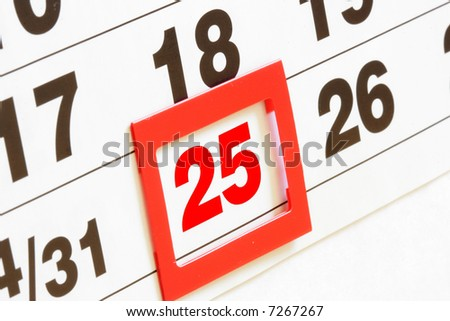Sheet of wall calendar with red mark on 25 december - Christmas - stock photo