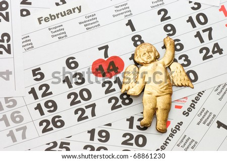 Sheet of wall calendar with red mark on 14 February - Valentines day - stock photo