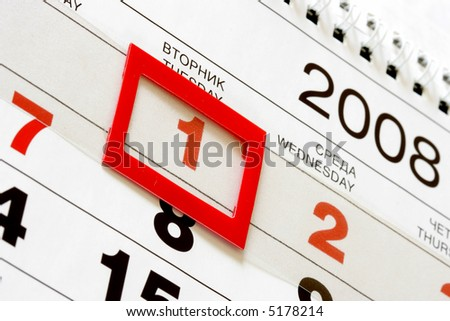 Sheet of wall calendar with red mark on 1-st January 2008 - stock photo