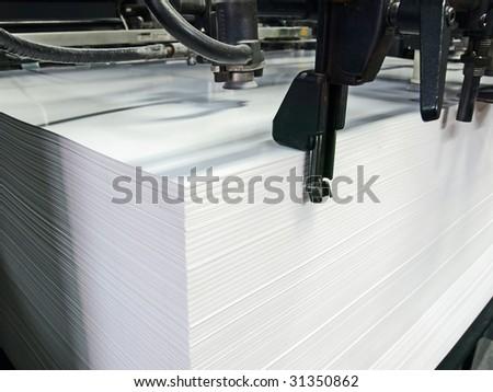Sheet offset machine draws in paper - stock photo