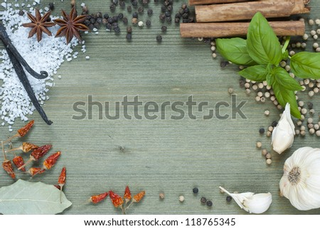 sheet paper and spices, food ingredients on wooden table background - stock photo