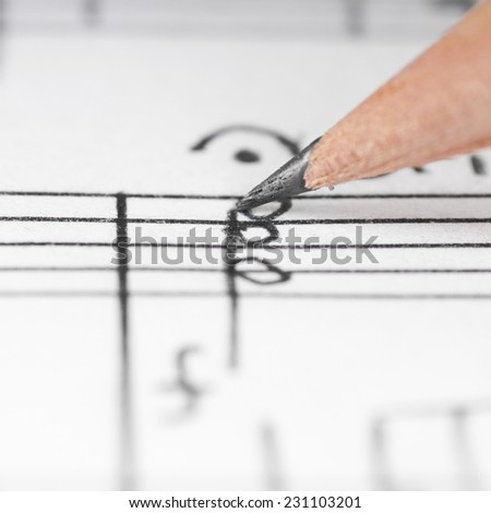 Sheet sheet and pencil, shallow DOF - stock photo