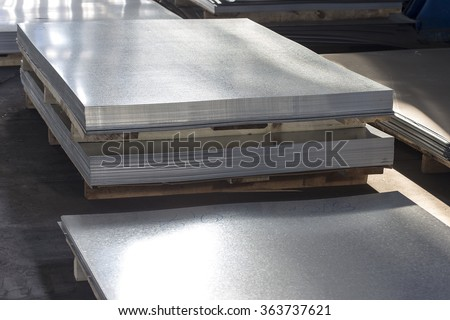 sheet tin metal in production hall - stock photo