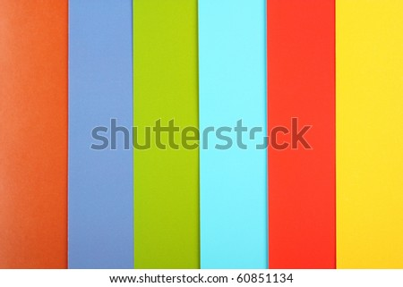 Sheets of a multi-colored paper laid out abreast