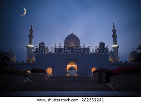 Sheik Zayed Mosque at Abu Dhabi, UAE, with the moon in the back ground. - stock photo