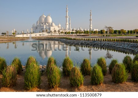 Sheikh Zayed Mosque in Middle East United Arab Emirates with reflection on water. Abu Dhabi. - stock photo