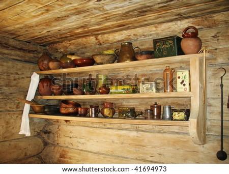 Shelf for kitchen utensils in ancient russian kitchen. - stock photo