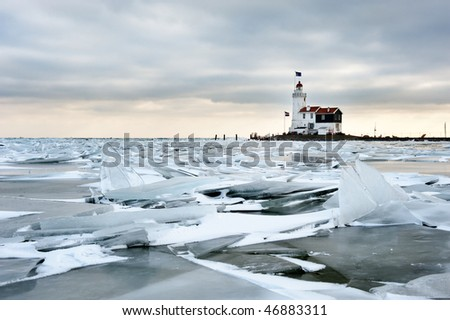 shelf ice and lighthouse  in Marken a small village near Amsterdam The Netherlands - stock photo