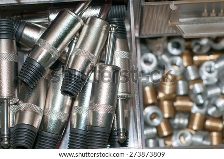 shelf unit for various types of audio connectors - stock photo