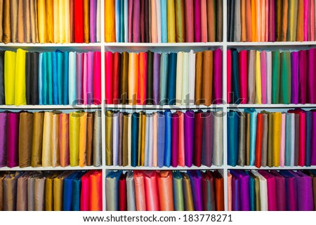 Shelf with a wide selection of colorful fabrics.