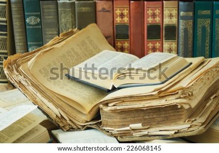 Shelf with antique books - stock photo