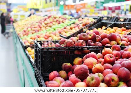 shelf with apples - stock photo